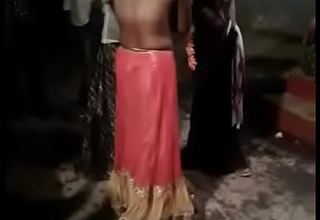 Public Desi bhabhi bumping off dresses while dancing