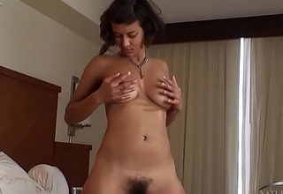 Sonya N vibes her hairy pussy on the bed