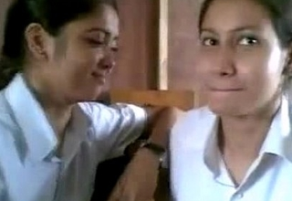 Two Indian School Girl Giving a kiss In Class