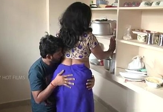 Indian mother with an increment of son romance in kitchen
